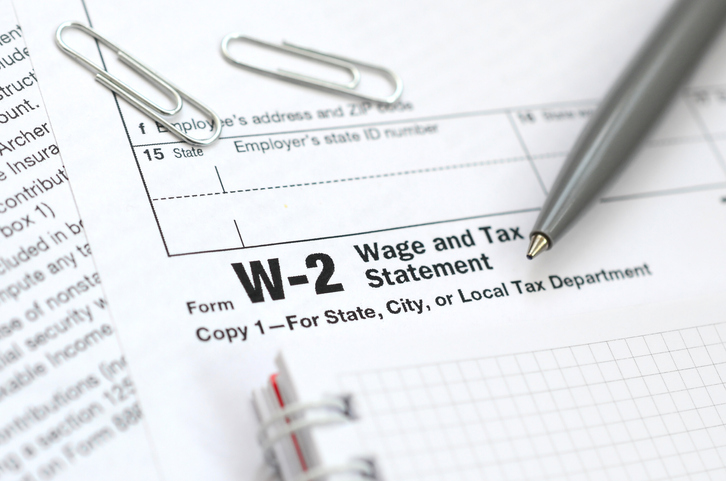 Close up of W-2 form with notebook