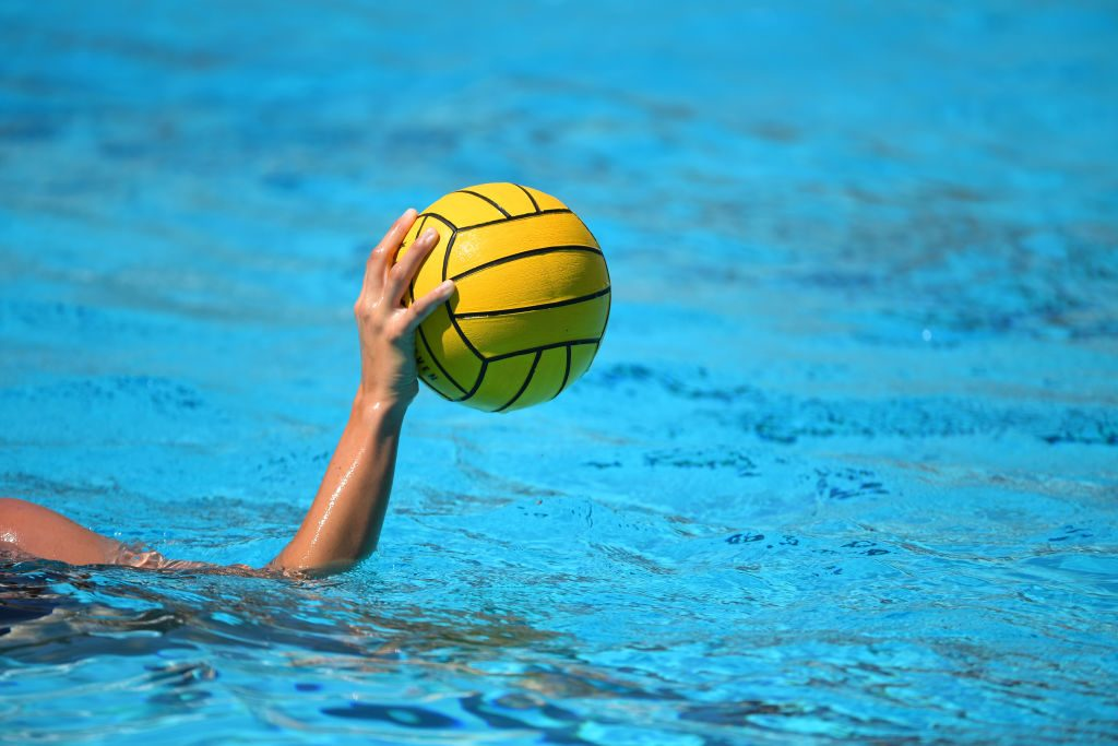 Hand holding water polo ball
