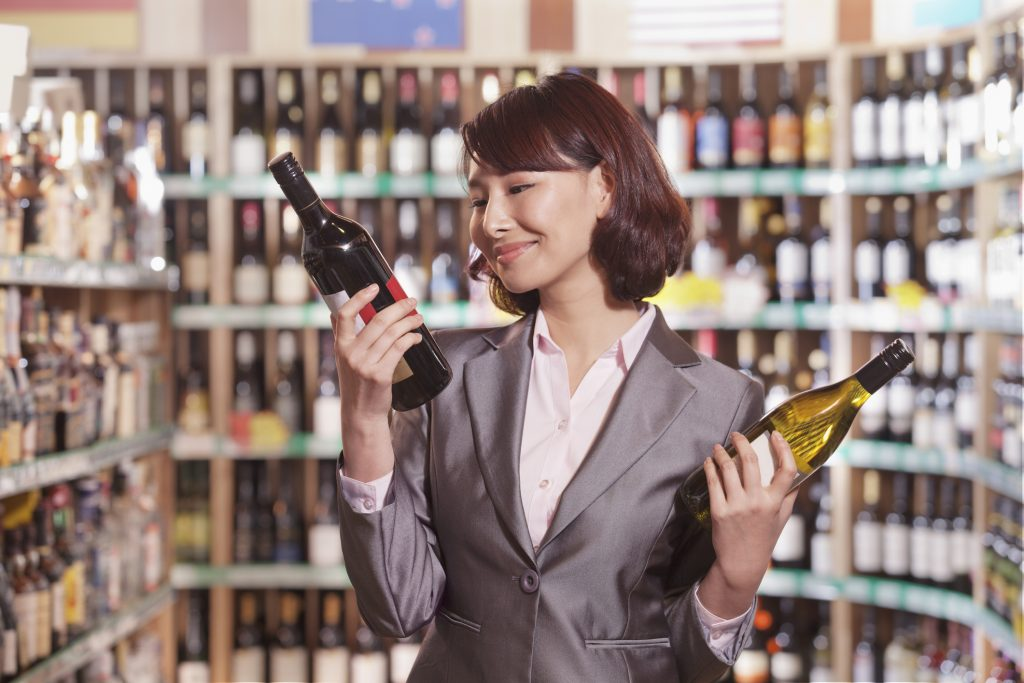 Woman shopping for alcohol