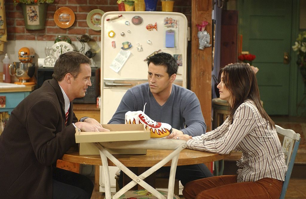 A scene from 'Friends' with Joey, Monica, and Chandler |  NBCU Photo Bank