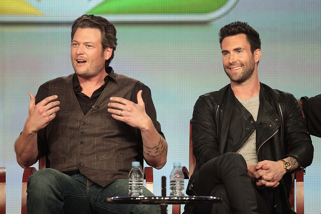"Coach Blake Shelton and Coach Adam Levine speak onstage during the ""The Voice"" panel."