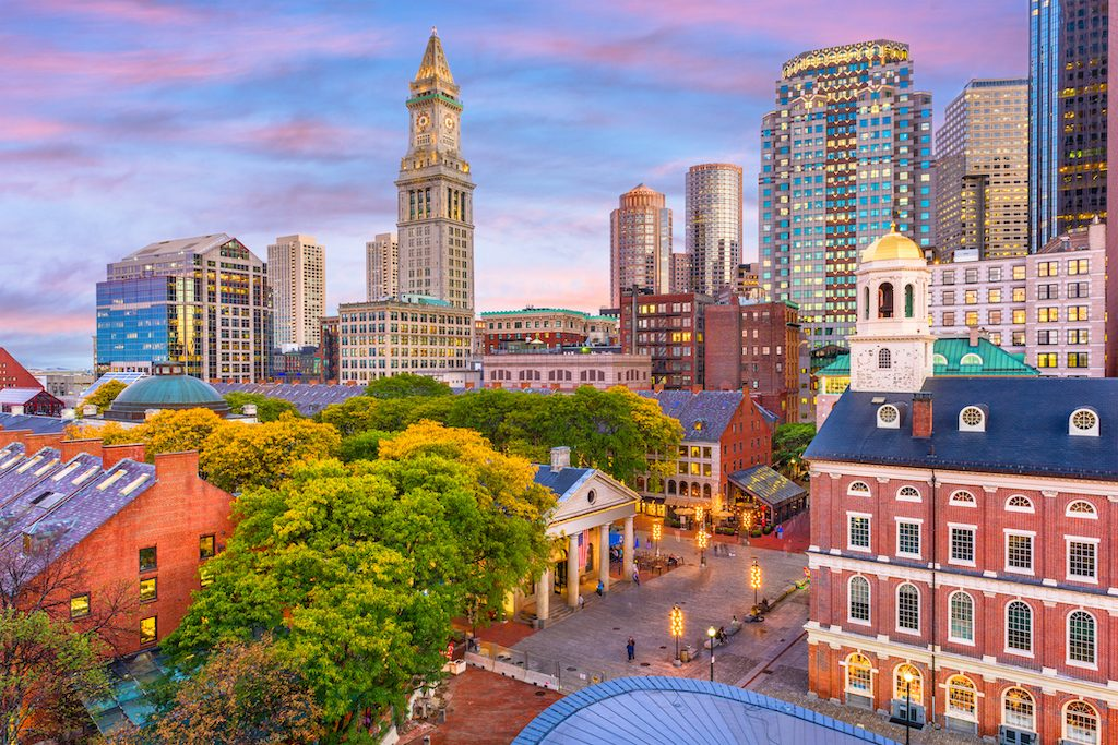 Quincy Market in front of Boston, Massachusetts skyline