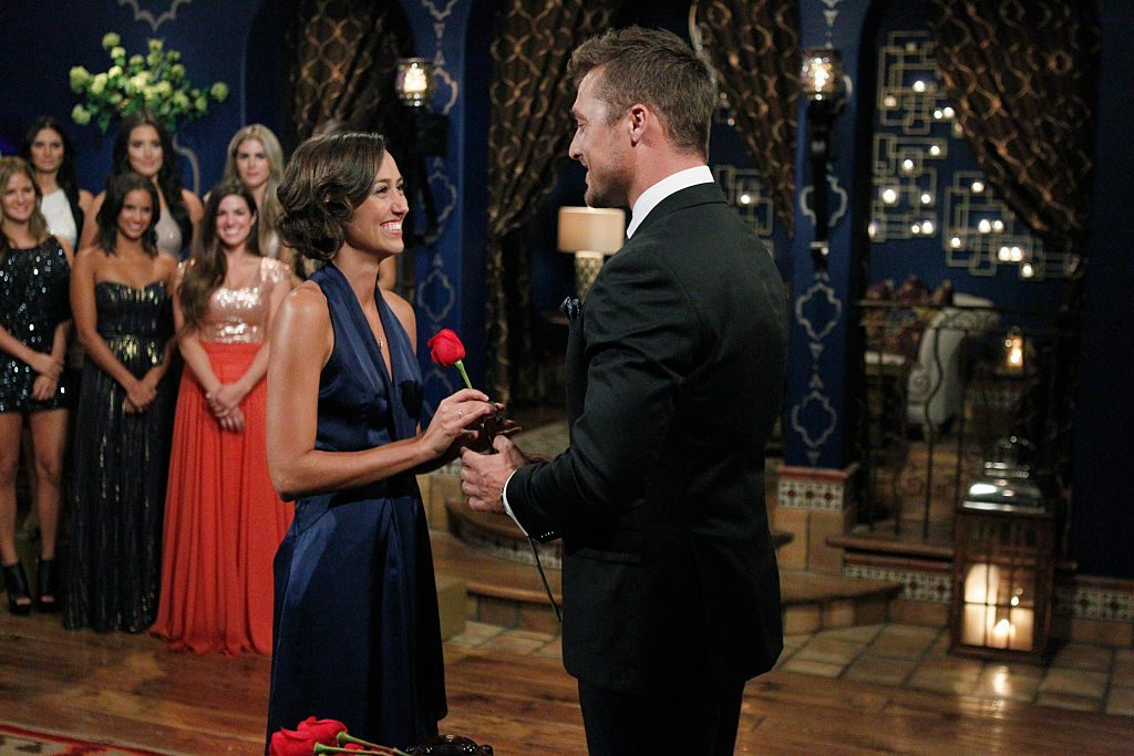 Contestant Kelsey Poe gets a rose from Chris Soules