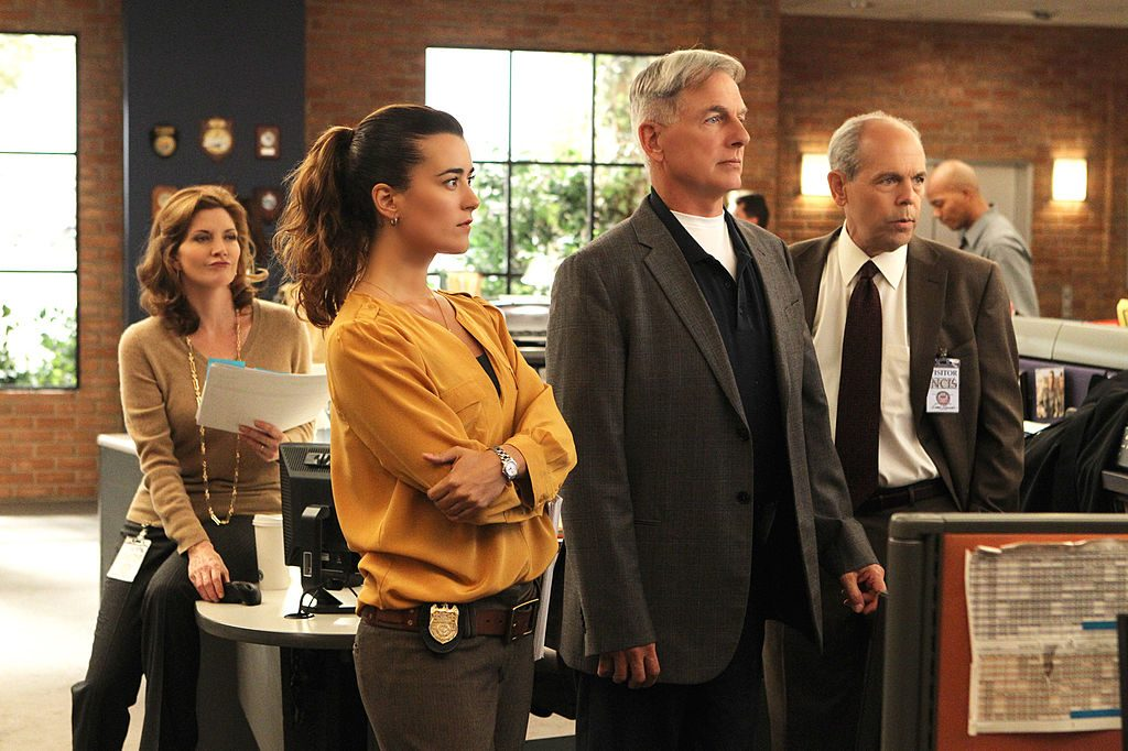 Cote de Pablo, Mark Harmon, and NCIS cast members | Monty Brinton/CBS via Getty Images