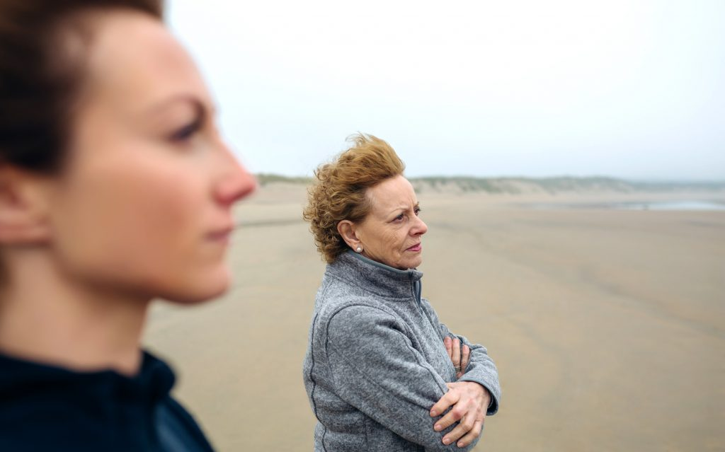 Two women looking at sea
