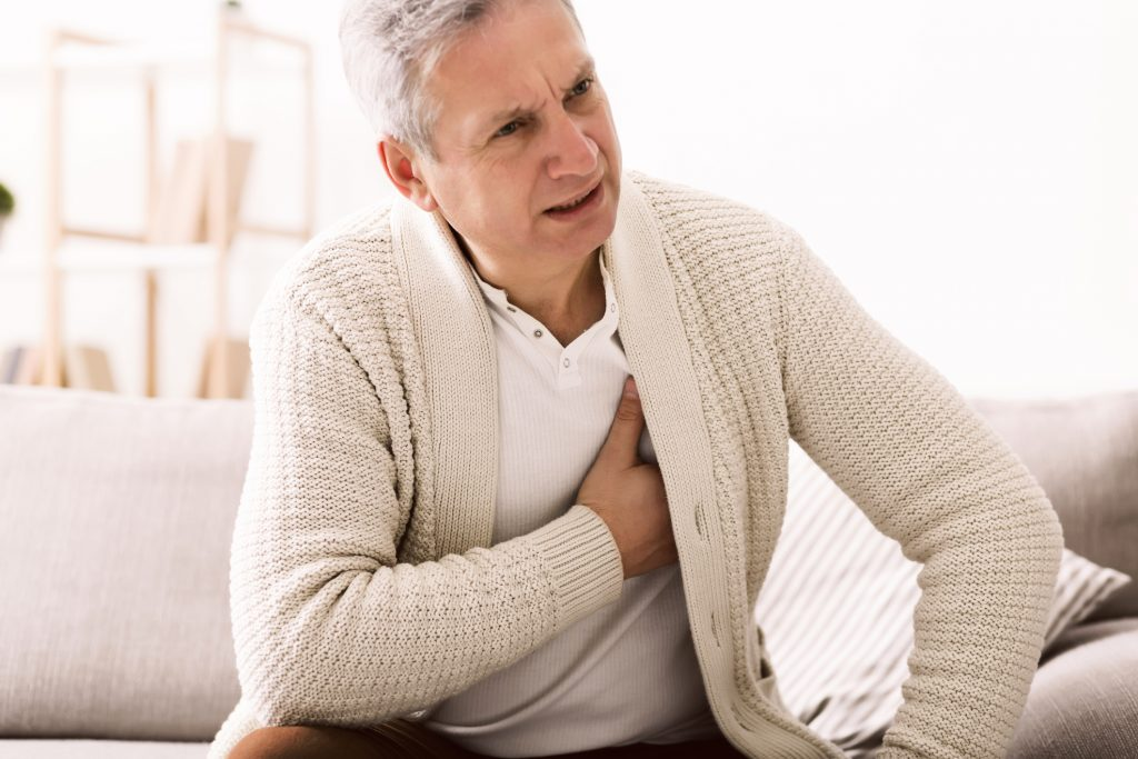 Mature man with heartburn