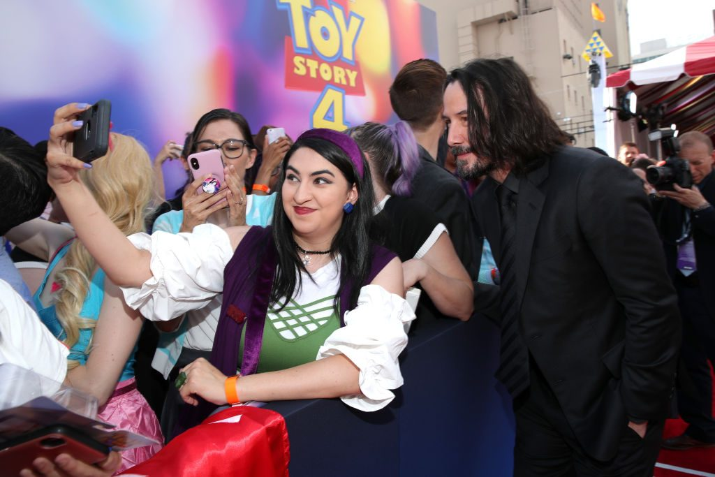 Keanu Reeves (R) participates in the world premiere of Disney and Pixar's Toy Story 4