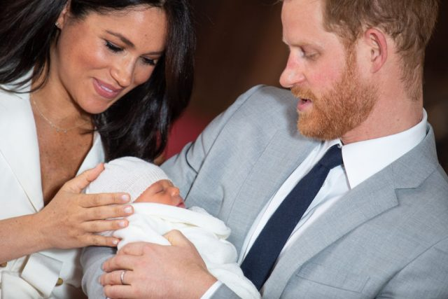 Prince Harry, Duke of Sussex and Meghan, Duchess of Sussex, pose with their newborn son Archie Harrison Mountbatten-Windsor.