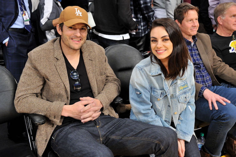 Ashton Kutcher and Mila Kunis cleverly mock a tabloid cover about themselves