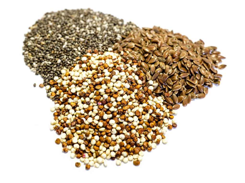 Seeds: quinoa chia and flax seeds isolated on white background