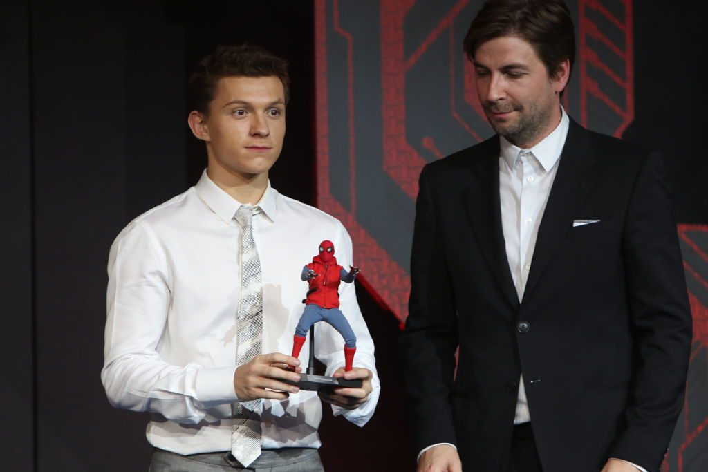 Tom Holland (L) and American director Jon Watts