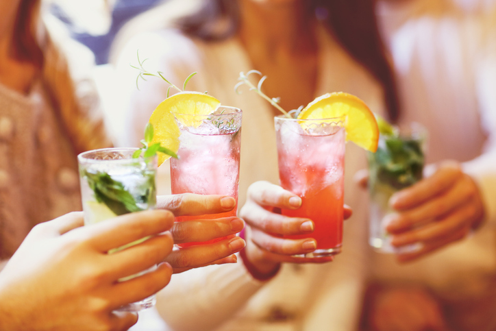 People holding cocktails