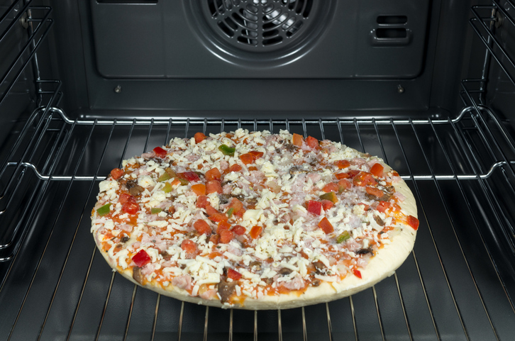 A frozen pizza on an oven rack