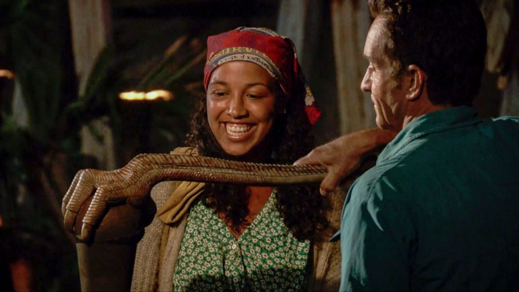 Jeff Probst extinguishes Julia Carter's torch at Tribal Council