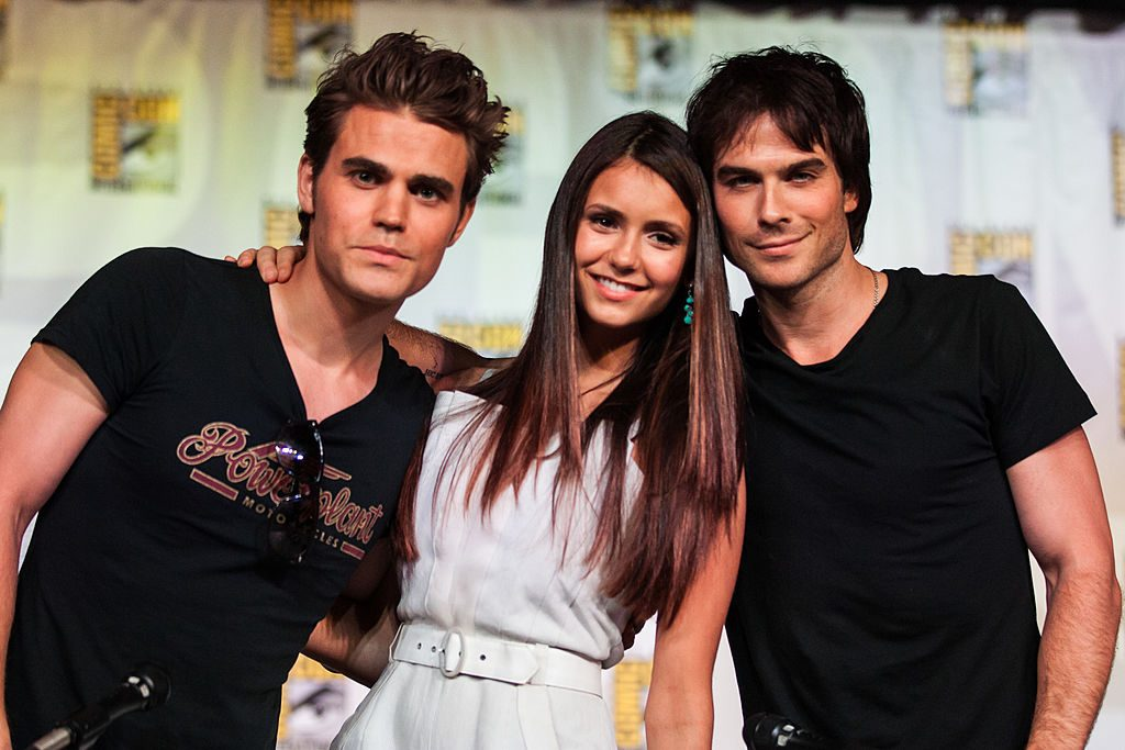 (L-R) Actors Paul Wesley, Nina Dobrev, and Ian Somerhalder attend The Vampire Diaries panel at San Diego Convention Center on July 14, 2012