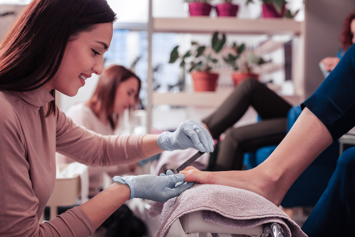 Nail specialist doing a pedicure
