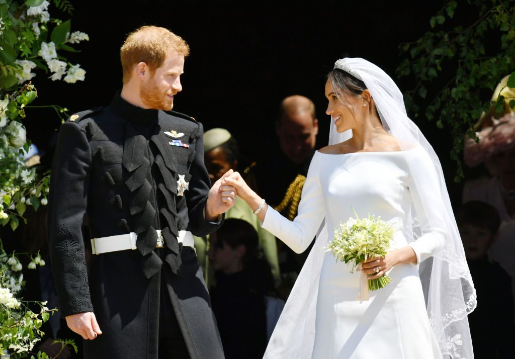 Prince Harry and Meghan Markle emerge from the West Door of St George's Chapel, Windsor Castle, in Windsor, on May 19, 2018 after their wedding ceremony.