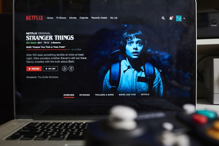'Stranger Things' displayed on laptop.