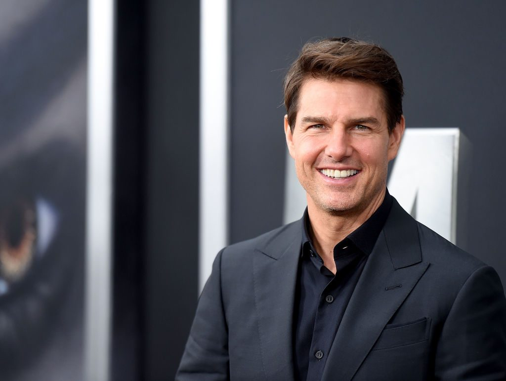 Tom Cruise attends a premiere.