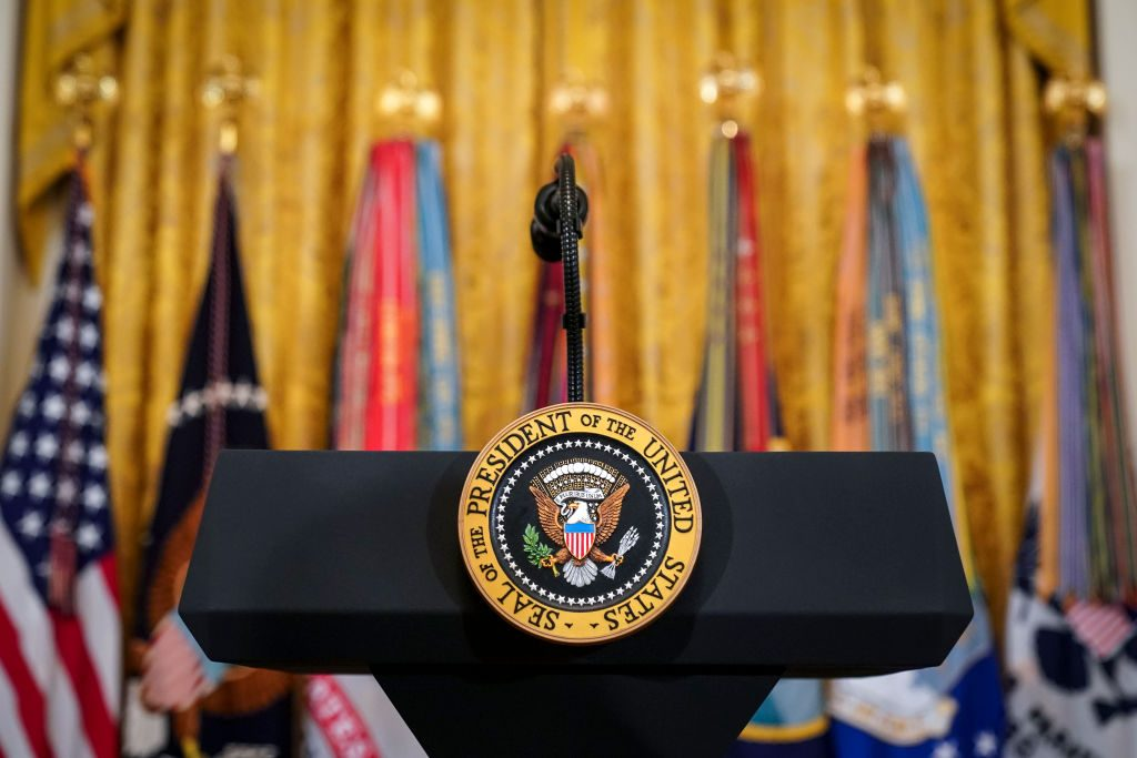 The presidential seal on a podium