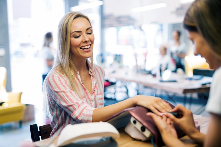 Happy woman at the nail salon