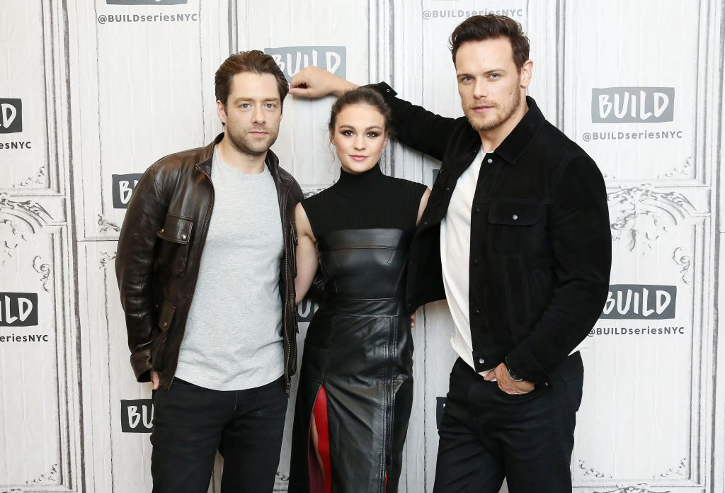 Actors Richard Rankin, Sophie Skelton and Sam Heughan | Monica Schipper/Getty Images