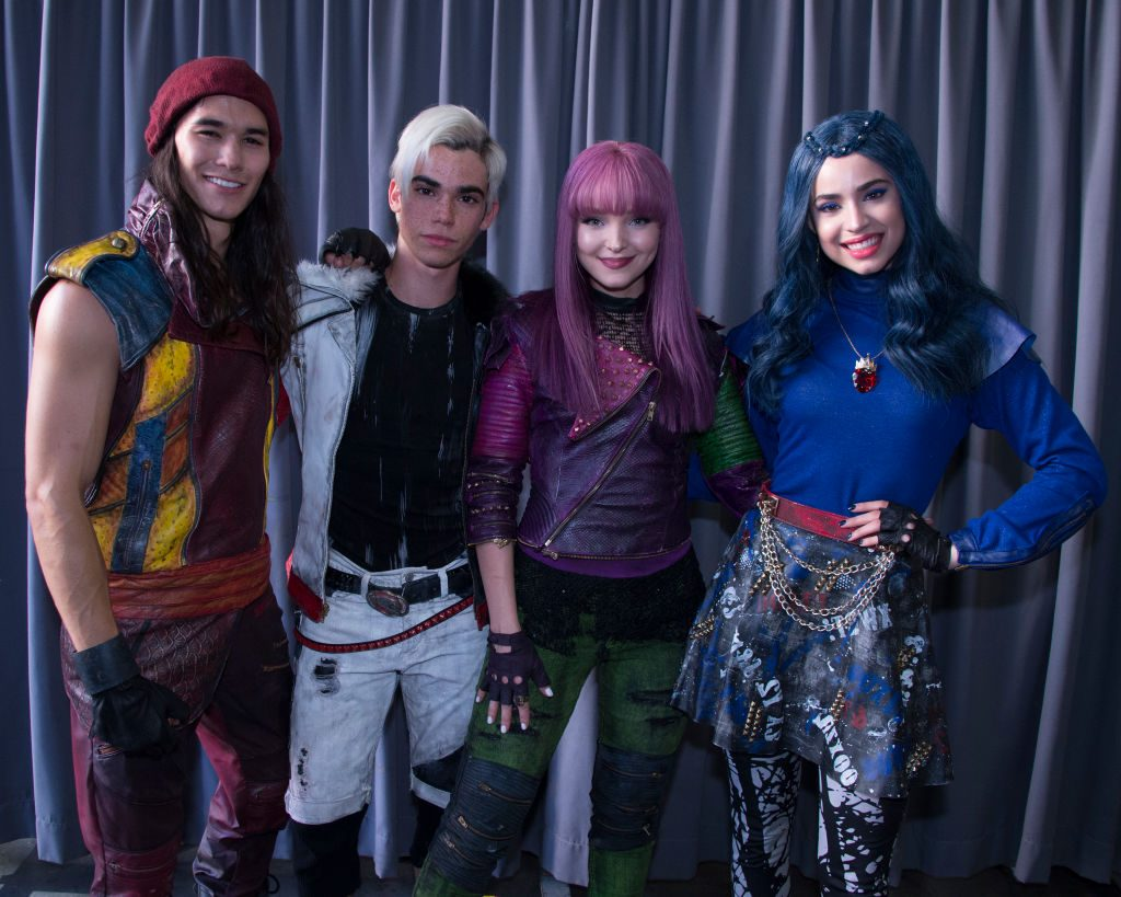 Cameron Boyce with Dove Cameron, Sofia Carson, and BooBoo Stewart on set of Descendants  | Eric McCandless/Walt Disney Television via Getty Images via Getty Images