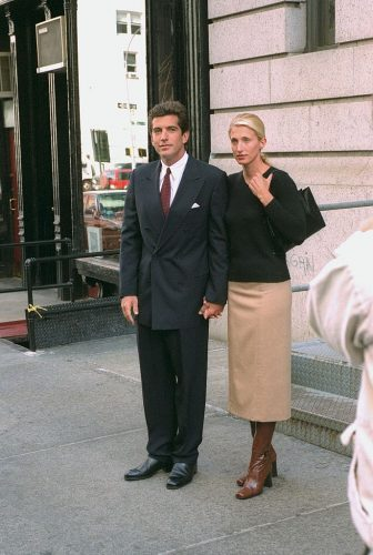 John F. Kennedy Jr. and bride Carolyn Bessette Kennedy stand in front of their apartment in Tribeca, 1996.