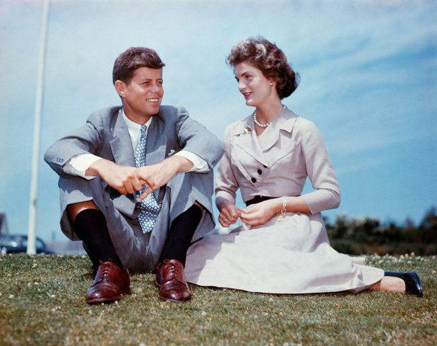 John F. Kennedy and Jacqueline Bouvier sit together in the sunshine at Kennedy's family home at Hyannis Port, Massachusetts, a few months before their wedding.