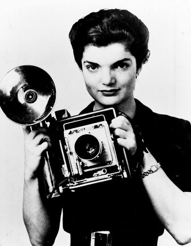 Jacqueline Bouvier Kennedy Onassis with camera