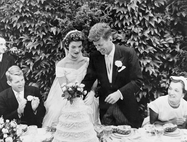 John F. Kennedy and Jacqueline Bouvier cutting their wedding cake after their marriage in Newport, Rhode Island.