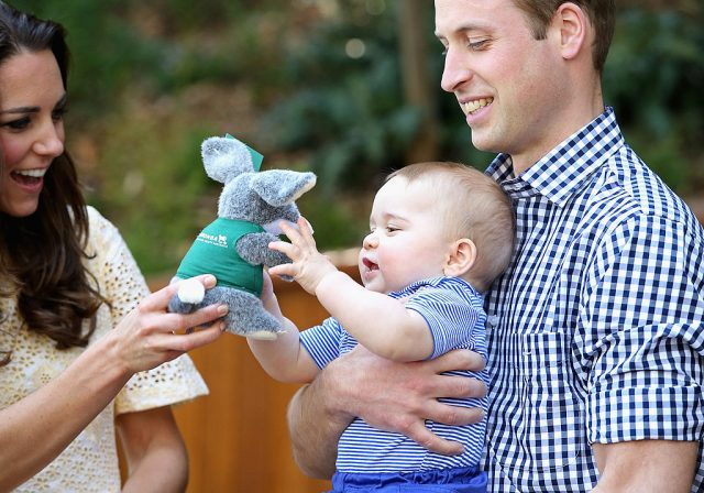 Kate Middleton and Prince William with Prince George.
