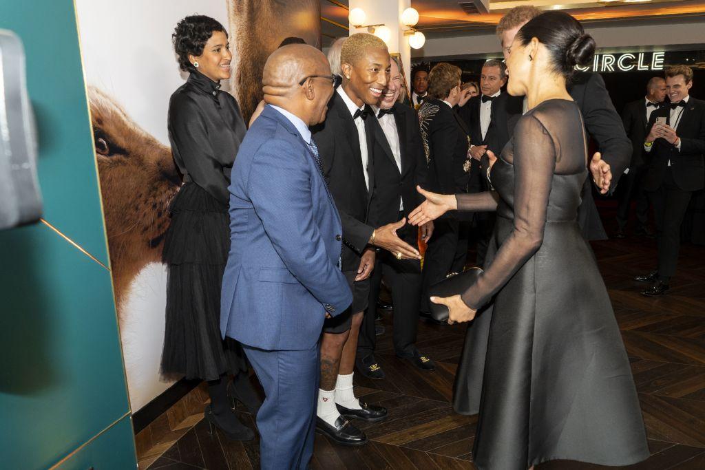 Prince Harry and Meghan Markle meet Pharrell