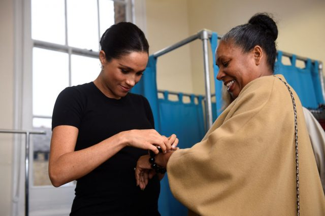 Meghan Markle puts a bracelet on Patsy Wardally during visit to Smart Works on January 10, 2019
