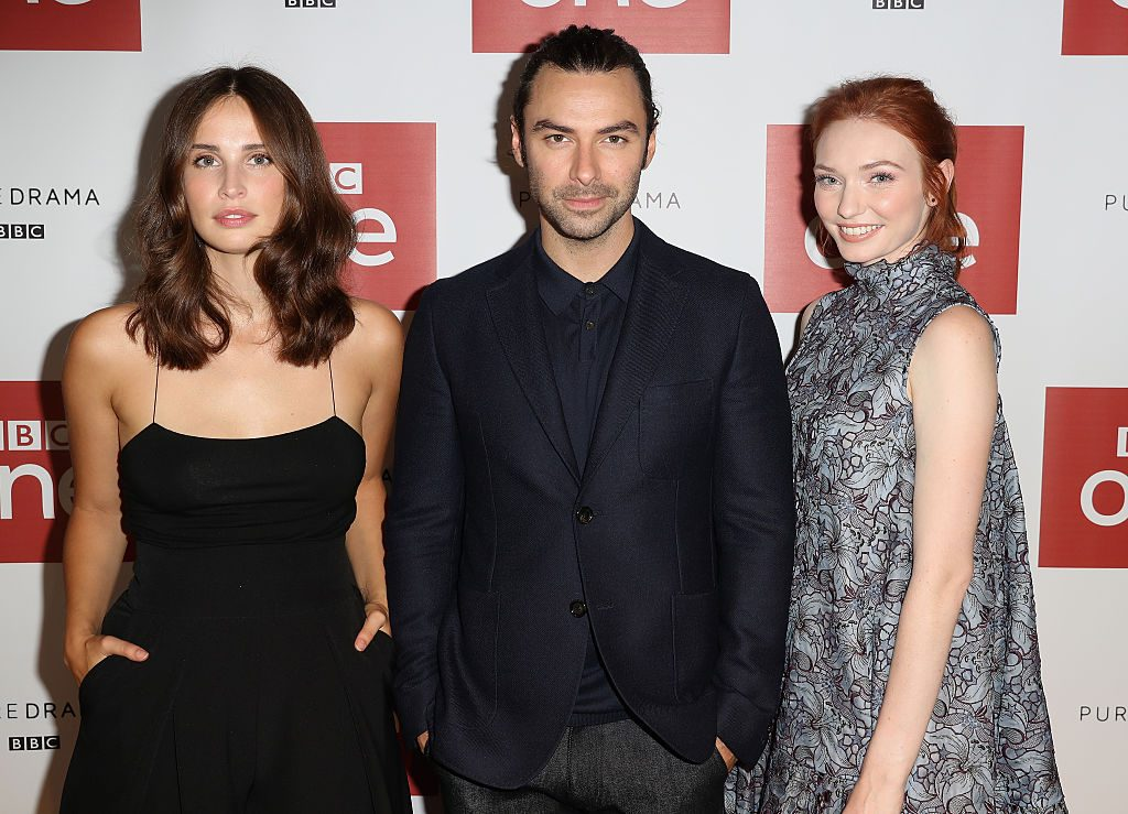 Actor Aidan Turner, actress Heida Reed and actress Eleanor Tomlinson at the Poldark Series 2 Preview Screening | Chris Jackson/Getty Images
