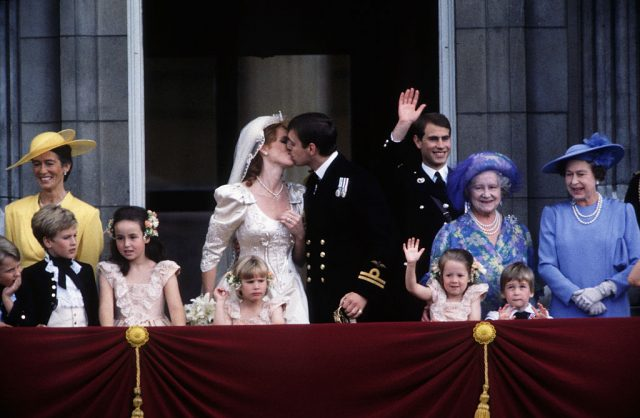 Prince Andrew and Sarah Ferguson kissing on the balcony of Buckingham Palace on their wedding day in 1986