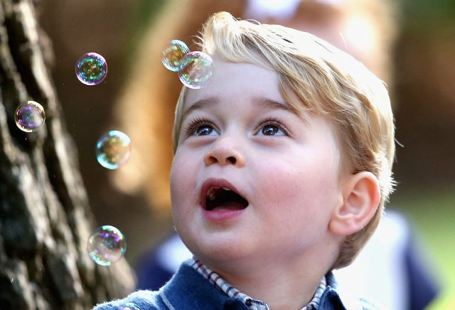 Prince George watching bubbles at party during tour of Canada in 2016