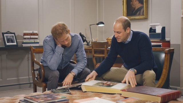 Prince Harry and Prince William look through family photos.