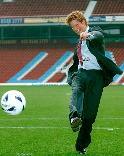 Prince Harry playing soccer in 2002.