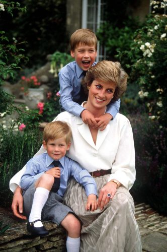 Prince Harry with Princess Diana and Prince William.