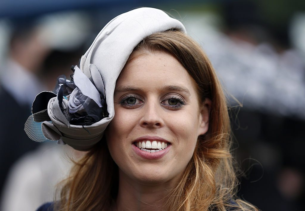 Princess Beatrice smiles during a garden party