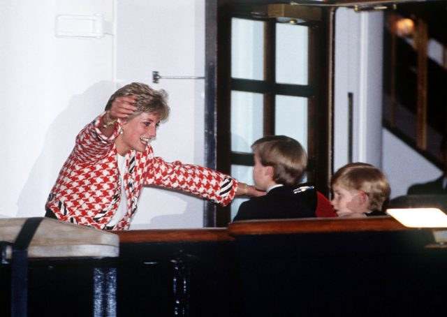 The Princess of Wales greets her sons Prince William and Prince Harry in 1991.