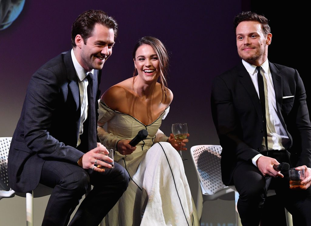 Richard Rankin, Sophie Skelton and Sam Heughan   Dia Dipasupil/Getty Images for SCAD