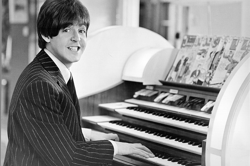 Paul McCartney sitting at organ piano