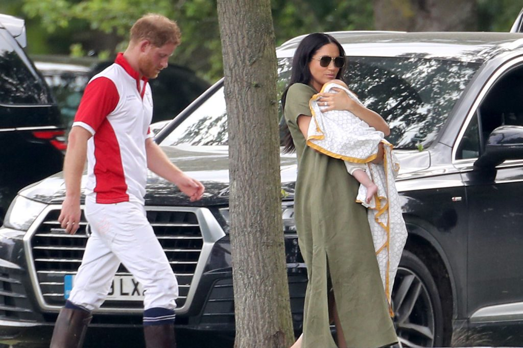 Meghan Markle holding baby Archie with Prince Harry at Polo Day.