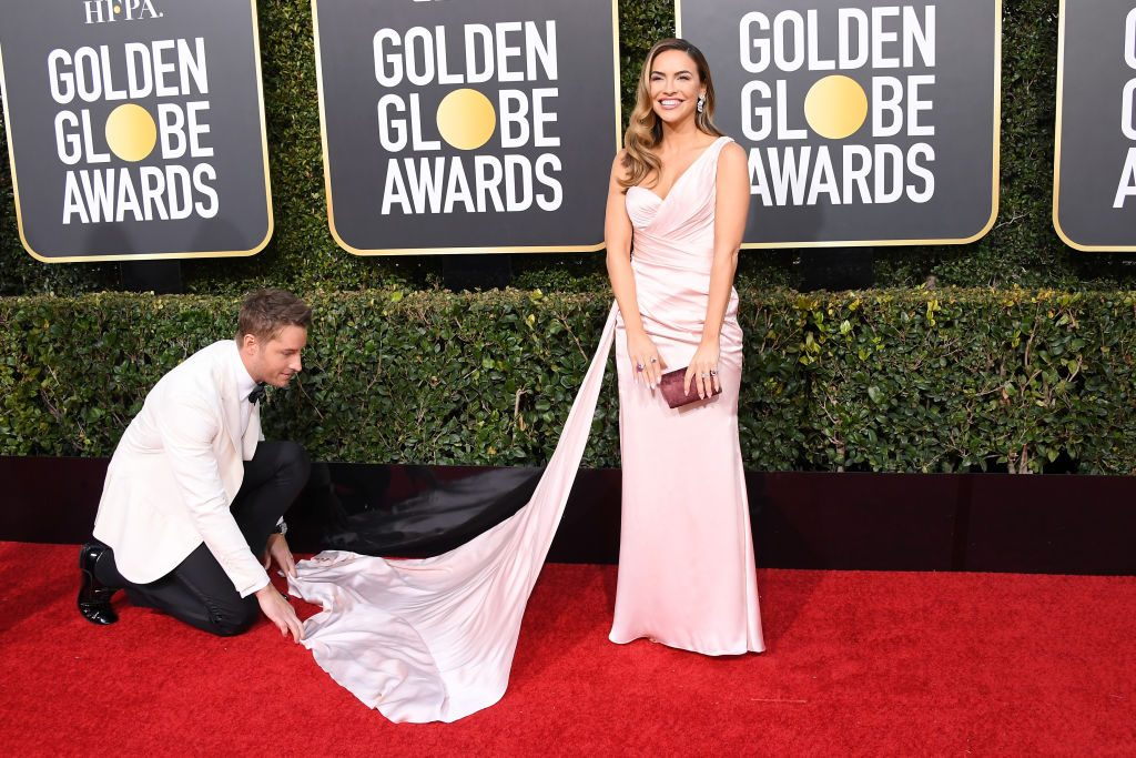 Justin Hartley fixes the dress of his wife, Chrishell Stause.