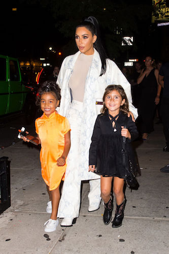 Kim Kardashian with North and Penelope