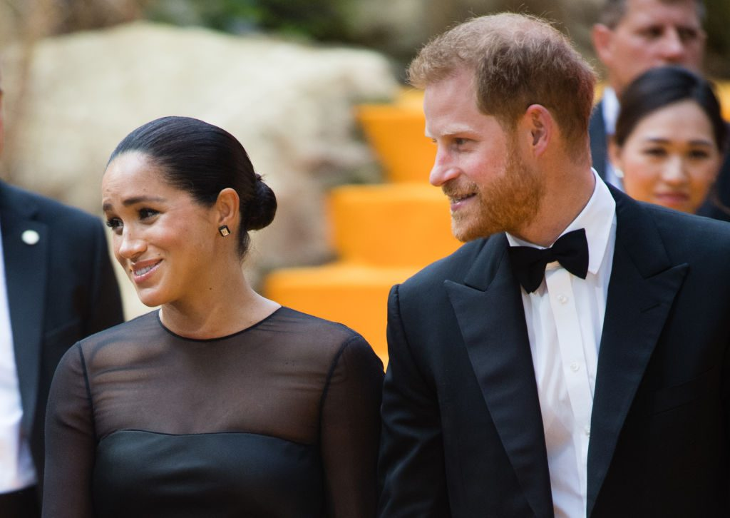 Prince Harry and Meghan Markle stand next to each other