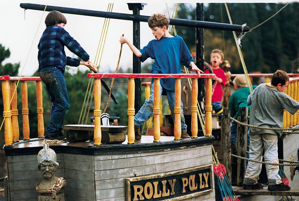 Twins Jeremy Roloff (in blue shirt) and Zachary (in red shirt) playing with friends on the pirate ship