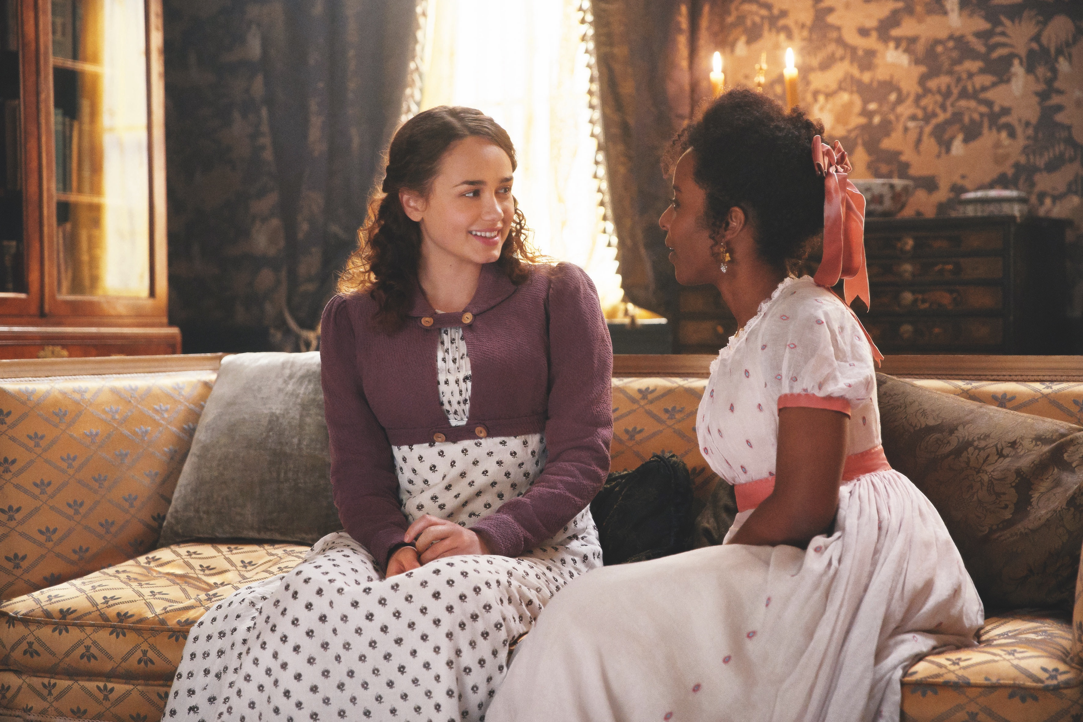 Rose Williams and Crystal Clarke sitting on a couch in 'Sanditon' Season 1